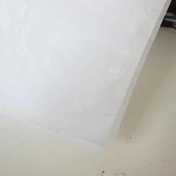 trim-edges-of-tissue-paper